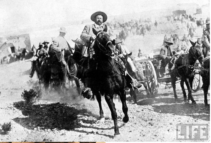 This 1914 photo courtesy of the LIFE magazine photo archive on Google shows Mexican General Pancho Villa riding with his men after victory at Torreon